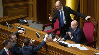 Ukrainian Prime Minister Arseny Yatseniuk (top L) and acting President Oleksander Turchinov (top R) talk to deputies as they attend a parliament session in Kiev March 27, 2014. (Reuters / Alex Kuzmin)
