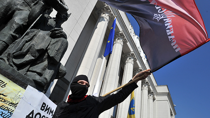 Supporters of the right wing party Pravyi Sector (Right Sector) protest in front of the Ukrainian parliament in Kiev on March 28, 2014. (AFP Photo / Ganya Savilov)