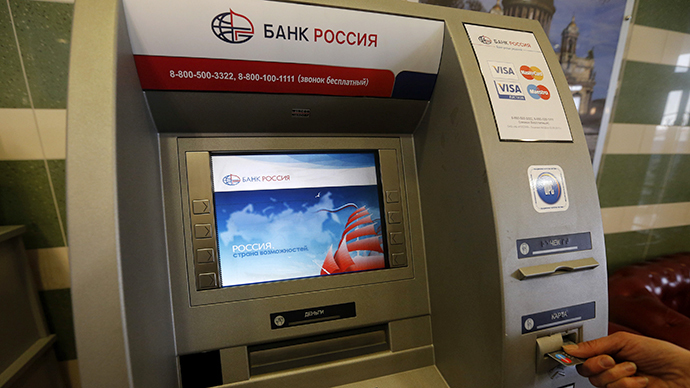 A client uses a Bank Rossiya automated teller machine (ATM) in St. Petersburg (Reuters / Alexander Demianchuk)