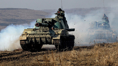 Russian tracked armored vehicles during drills (RIA Novosti / Vitaliy Ankov)