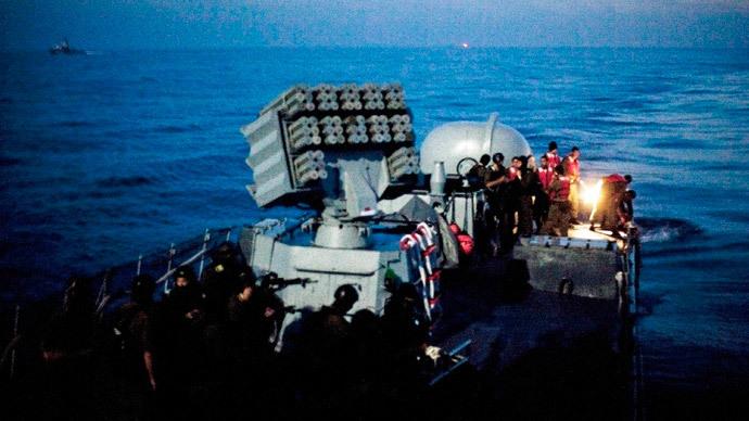 Israeli soldiers ride aboard a naval vessel in the Mediterranean Sea May 31, 2010.(Reuters / Uriel Sinai)