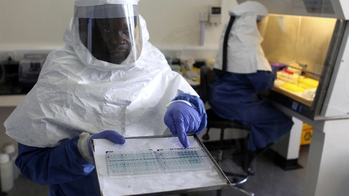 A doctor displays collected samples of the Ebola virus at the Centre for Disease Control in Entebbe, about 37km (23 miles) southwest of Uganda's capital Kampala, August 2, 2012. (Reuters/Edward Echwalu)