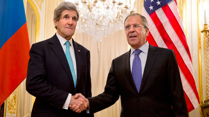 U.S. Secretary of State John Kerry (L) shakes hands with Russian Foreign Minister Sergei Lavrov before their meeting at the Russian Ambassador's residence in Paris March 30, 2014 (Reuters / Jacquelyn Martin)