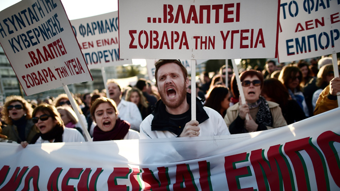 Pharmacists shout slogans during a demonstration outside the parliament in Athens on March 30, 2014 (AFP Photo / Aris Messinis)