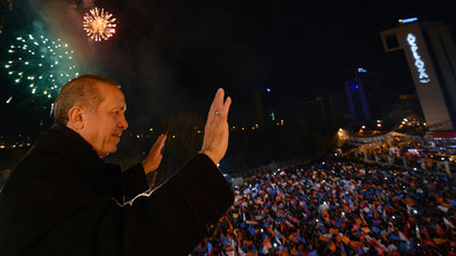 Turkey's Prime Minister Tayyip Erdogan greets his supporters in Ankara (AFP Photo)
