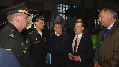 Russia's Prime Minister Dmitry Medvedev (2nd R), Deputy Prime Minister Dmitry Rogozin (R) and Sevastopol Mayor Alexei Chaliy (C) visit the 13th Ship-Repairing Yard of the Black Sea Fleet of the Russian Defense Ministry in Sevastopol, March 31, 2014.(Reuters / Alexander Astafyev)