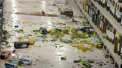 Broken bottles are seen on the floor after falling off the shelves at a CVS pharmacy, following a magnitude 5.1 earthquake in Fullerton, California March 29, 2014.  (Reuters / Gene Blevins)