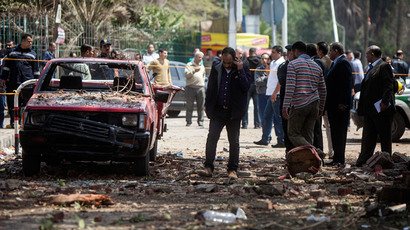 Egyptians inspect the damage after twin bombs struck police posts near Cairo University in the centre of Egypt's capital on April 2, 2014, which was followed by a third blast as police and journalists gathered at the scene. (AFP Photo / Manmoud Khaled)