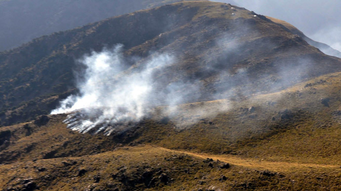 Smoke rising apparently after a cross-border NATO air strike on Pakistani border posts on a mountain in the Mohmand tribal district, on November 26, 2011.(AFP Photo / ISPR)