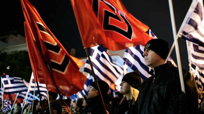 Member of the far right Golden Dawn party hold flags as they take part in a rally in Athens on February 1, 2014. (AFP Photo / Louisa Gouliamaki)