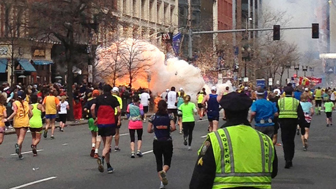 Runners continue to run towards the finish line of the Boston Marathon as an explosion erupts near the finish line of the race in this photo exclusively licensed to Reuters by photographer Dan Lampariello after he took the photo in Boston, Massachusetts, April 15, 2013. (Reuters / Dan Lampariello)