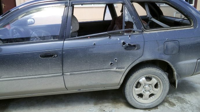 Bullet holes are seen in the car in which two foreign journalists were travelling when they were shot at, in Khost province April 4, 2014. (Reuters)