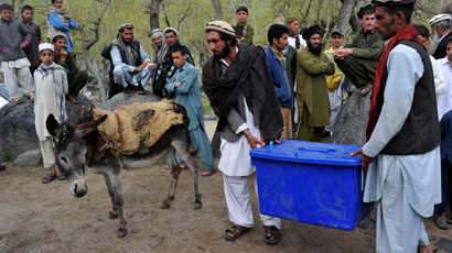 Villagers saddle donkeys with election materials in the Dara-e-Noor district of Nangarhar province in Eastern Afghanistan on April 4, 2014.( AFP Photo / Noorullah Shirzada )
