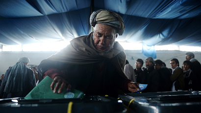 An Afghan man casts his vote at a local polling station in Kabul on April 5, 2014. (AFP Photo / Shah Marai)