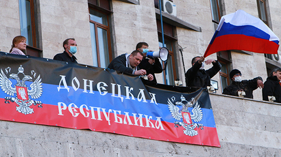 Participants in the rally, staged in Donetsk by supporters of the referendum on Donetsk Region's status, are seen on the regional administration building on April 6, 2014. (RIA Novosti / Irina Gorbaseva)