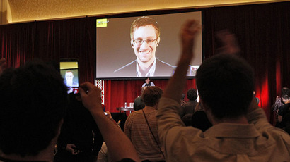 Supporters of Amnesty International cheer and shoot mobile phone videos as accused government whistleblower Edward Snowden is introduced via teleconference during the Amnesty International Human Rights Conference 2014 in Chicago, April 5, 2014. (Reuters / Frank Polich)
