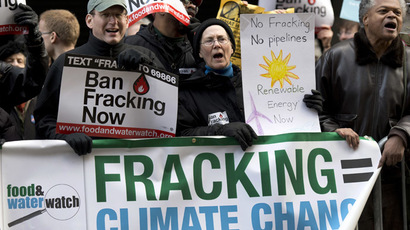 Opponents of the hydraulic fracturing shout during a demonstration at the site of a Democratic party fundraiser March 20, 2014 in New York.  (AFP Photo/Don Emmert)