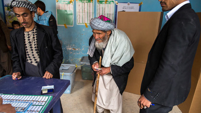 Afghan men wait to vote at a polling station in Mazar-i-sharif April 5, 2014.(Reuters / Zohra Bensemra)
