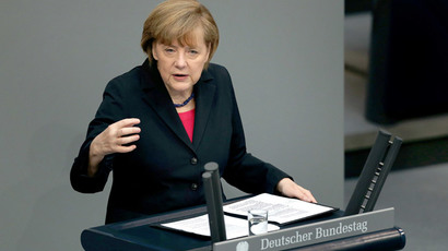 German Chancellor Angela Merkel delivers a speech during a debate on the 2014 federal budget at the lower house of parliament Bundestag on April 9, 2014, in Berlin. (AFP Photo / Ronny Hartmann