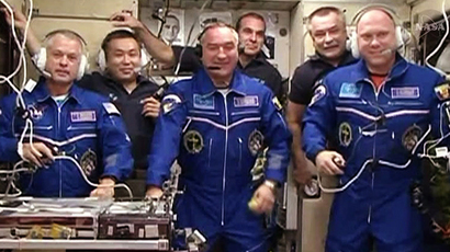 This still image from NASA TV shows Expedition 39, now a six-member crew, talking to family and mission officials moments after entering the International Space Station for the first time on March 27, 2014. (AFP Photo / NASA TV)
