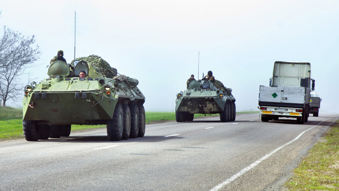 Ukrainian armoured personnel carriers (APC) drive in the Donetsk region on the road from Donetsk to Odessa on April 15, 2014. (AFP Photo / Alexey Kravtsov)