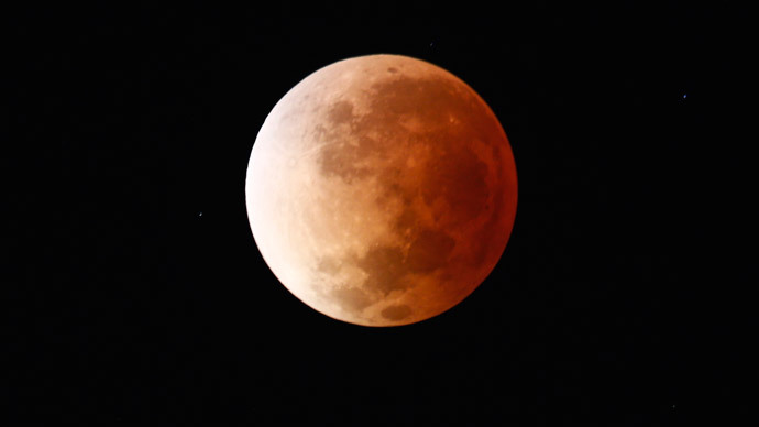The moon is seen as it begins a total lunar eclipse that will turn the moon red over Buenos Aires April 15, 2014. (Reuters / Marcos Brindicci)