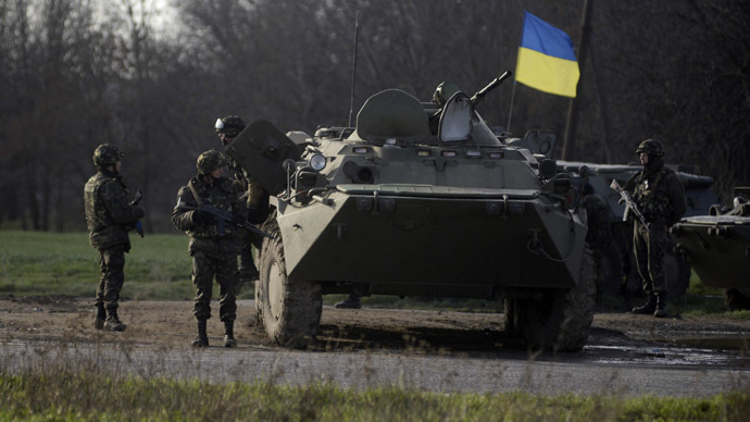 Ukranian troops stand guard at a checkpoint near the city of Izium in the Kharkiv region of east Ukraine April 15, 2014. (Reuters / Maks Levin)