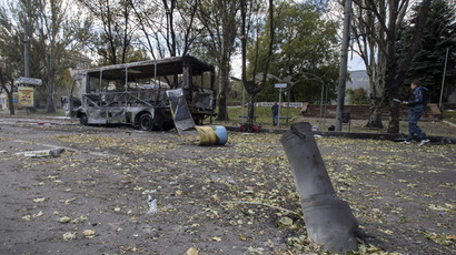 The remains of a rocket shell is seen in front of a burnt-out bus on a street in Donetsk, eastern Ukraine, October 1, 2014. (Reuters/Shamil Zhumatov)
