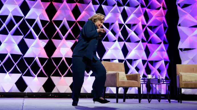 Feds charge woman who hurled shoe at Hillary Clinton