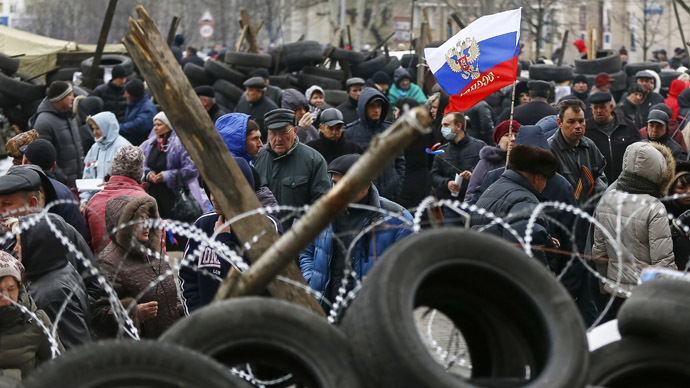 Pro-Russia protesters gather in front of a barricade outside a regional government building in Donetsk, in eastern Ukraine April 11, 2014. (Reuters/Gleb Garanich)