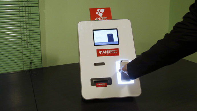 A smartphone with a QR code is scanned on Hong Kong's first bitcoin ATM during a demonstration at a bitcoin exchange in Hong Kong March 13, 2014. (Reuters/Bobby Yip)