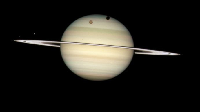 An image of four moons of Saturn passing in front of their parent planet in seen this image taken by NASA's Hubble Space Telescope February 24, 2009 and released by NASA March 17, 2009. (Reuters/NASA)