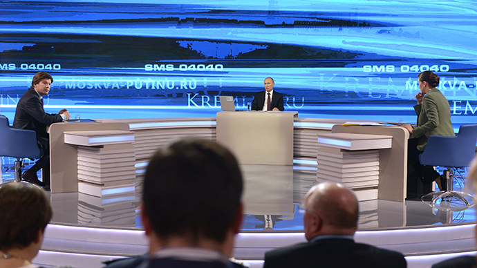 "Russian President Vladimir Putin replies to questions from Russian citizens at the Gostiny Dvor studio during annual question and answer session ""Direct Line with Vladimir Putin,"" broadcast live by the Rossiya 1, Rossiya 24 television channels and the Mayak (Beacon), Vesti FM and Radio of Russia radio stations. Left: Kirill Klemyonov, Head of the Channel One News Broadcasting Directorate. Right: Rossiya TV Channel journalist Maria Sittel (RIA Novosti / Alexey Nikolsky)"