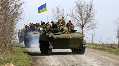 Ukrainian soilders drive on an airborne combat vehicle near Kramatorsk, in eastern Ukraine April 16, 2014. (Reuters/Marko Djurica)