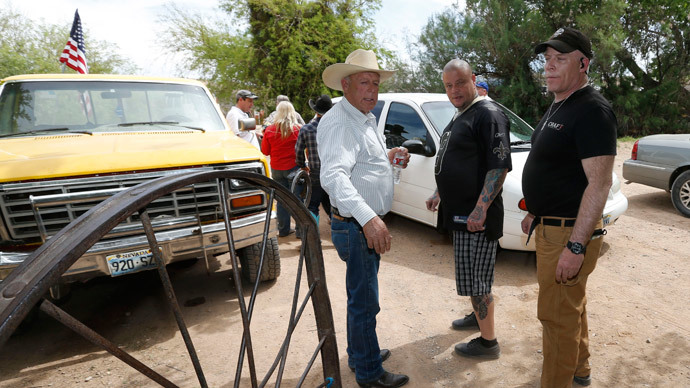 Rancher Cliven Bundy (L), and armed security guards leave his ranch house west of Mesquite, Nevada.  (George Frey / Getty Images / AFP)