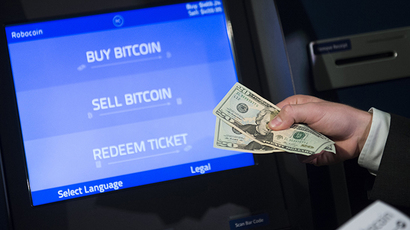 Robocoin CEO Jordan Kelley demonstrates how to buy and sell bitcoins during a demonstration of a Robocoin kiosk on Capitol Hill in Washington, DC (AFP Photo / Saul Loeb)