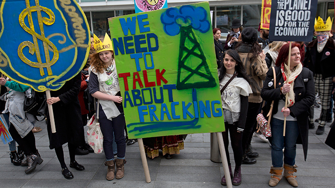 Demonstrators hold banners during an anti-fracking protest in central London (Reuters / Neil Hall)