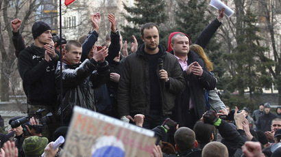 Protest leader Pavel Gubarev (2nd R, top) and other pro-Russian demonstrators take part in a rally in front of regional government building in Donetsk March 5, 2014. (Reuters)