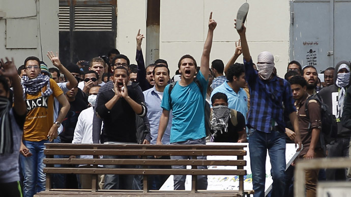 Students, who are supporters of the Muslim Brotherhood and ousted President Mohamed Mursi, shout slogans during clashes with residents and police in a protest against the military and interior ministry in Cairo University at Kasr El Aini street in downtown Cairo April 9, 2014. (Reuters/Amr Abdallah Dalsh)