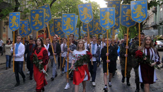 "Ukrainian ultra-nationalists carry emblems of 14th SS-Volunteer Division ""Galician"" as they march in the center of the western city of Lviv on April 27, 2014 to mark the 71st anniversary of 14th SS-Volunteer Division ""Galician"" foundation.  (RIA Novosti)"
