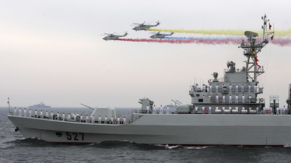"Helicopters fly past the Chinese Jiangwei II class naval frigate ""Luoyang"" (Reuters/Guang Niu)"