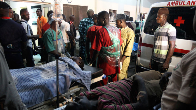 People who were injured during an explosion are seen on stretchers at Asokoro General Hospital in Abuja May 1, 2014. (Reuters / Afolabi Sotunde)