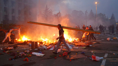 A protester walks past a burning anti-government tent camp near the trade union building in Odessa May 2, 2014. (Reuters / Yevgeny Volokin)