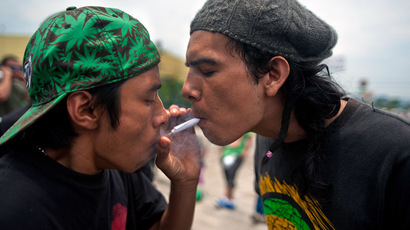 Activists smoke a joint during a march demanding the legalization of marijuana in San Salvador, El Salvador on May 3, 2014. (AFP Photo/Jose Cabezas)