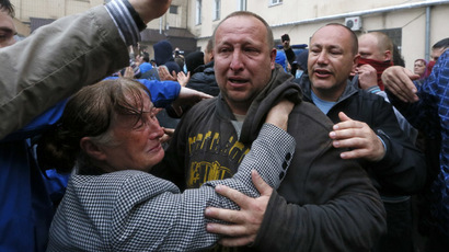 Participants of a rally welcome a man (C) who was just released from a city police department and who was earlier arrested after recent street battles between pro- and anti-Kiev protesters in the Black Sea port of Odessa May 4, 2014. (Reuters/Gleb Garanich)
