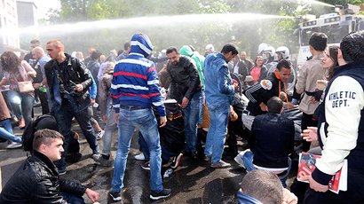 "Police use water cannon to disperse people arriving for the banned anti-Semitic congress, ""First European Conference of Dissidence"", organised by Chamber member Laurent Louis in Anderlecht, outside Brussels, on May 4, 2014 (AFP Photo / Nicolas Maeterlinck)"