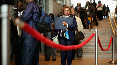 A woman  stands in line with some of the 1,500 people seeking employment during a job fair at the Arena Stage at the Mead Center for American Theater in Washington, DC (AFP Photo /  Chip Somodevilla)