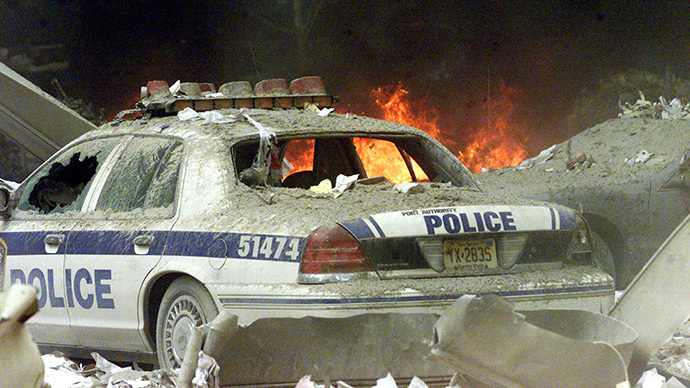 A police car sits amid rubble near the base of the destroyed World Trade Center towers in New York on September 11, 2001. (Reuters / Peter Morgan)