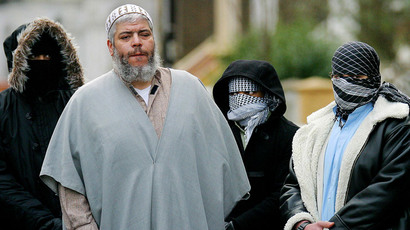 Sheikh Abu Hamza (2L) outside the North London Mosque at Finsbury Park surrounded by supporters. (Reuters)
