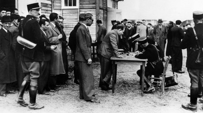 Picture dated May 1941 showing foreign Jews, especially male Polish Jews, who get registered by French policemen after their arrival in the transit camp of Pithiviers. (AFP Photo)